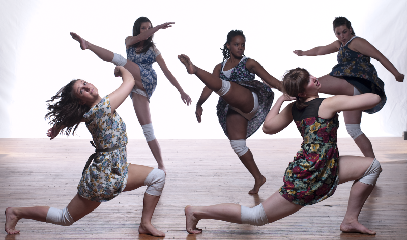 Five girls, in floral, perfecting their kicks